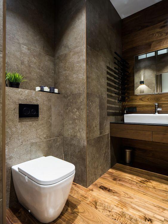 Thiết kế nội thất phòng tắm căn hộ sử dụng chất liệu đá và gỗ