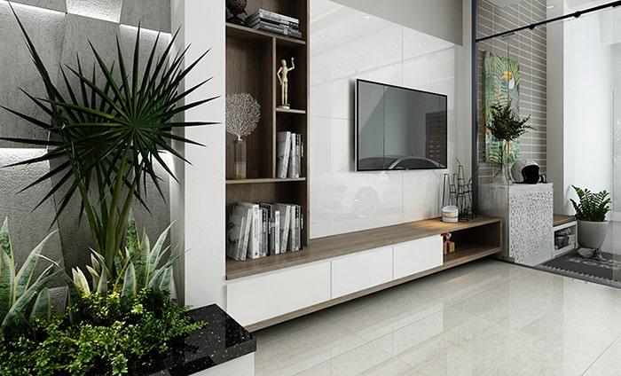 Kệ tivi được treo trên tường nhằm tiết kiệm diện tích tối đa